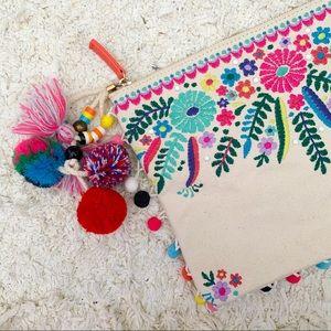 Steve Madden embroidered pom pom clutch bag